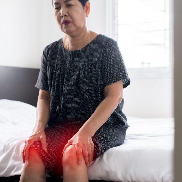 Senior,Asian,Woman,Suffering,From,Arthritis,Disease,female,Touching,Her,Injured